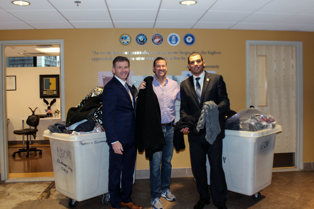 Andy McCawley, Dan Andelman, and Francisco Urena pose with donations from Winter Phest.
